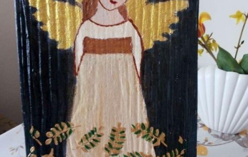 Anioł w liściach paproci